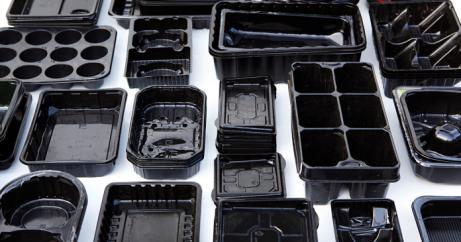 black-plastic-packaging-696x365